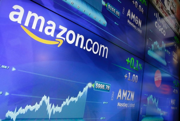 FILE - In this Tuesday, May 30, 2017, file photo, the Amazon logo is displayed at the Nasdaq MarketSite, in New York's Times Square. Amazon announced
