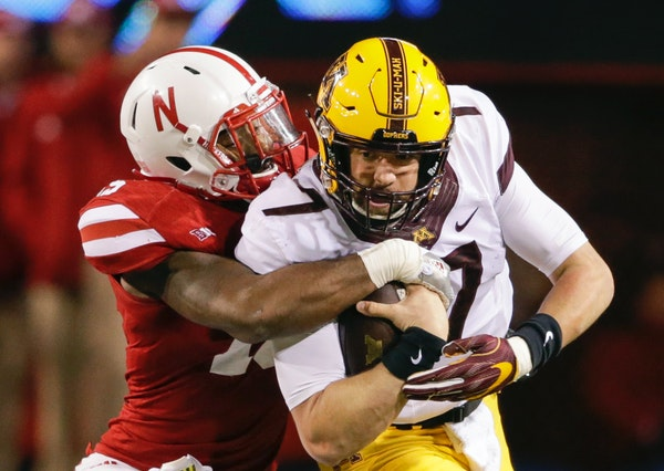 Mitch Leidner is tackled by Nebraska linebacker Michael Rose-Ivey during the second half last season. Plans are in the works for the Gophers and Cornh