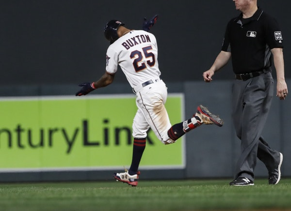 Minnesota Twins center fielder Byron Buxton (25) celebrated his bottom of the tenth inning home run to win the game 3/2.