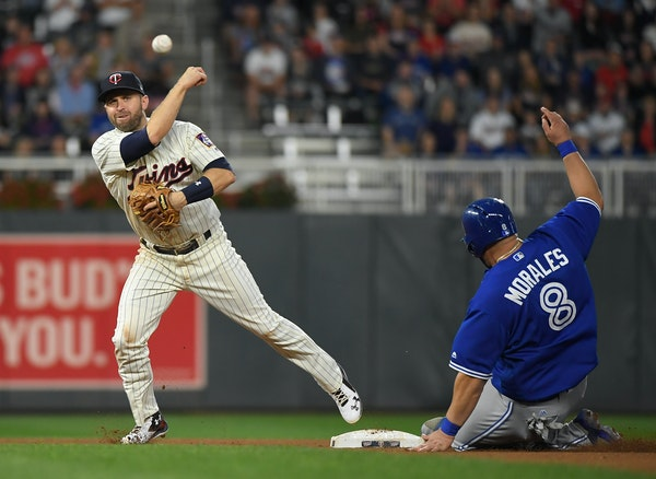 Blue Jays designated hitter Kendrys Morales was out at second as Twins second baseman Brian Dozier turned a double play.
