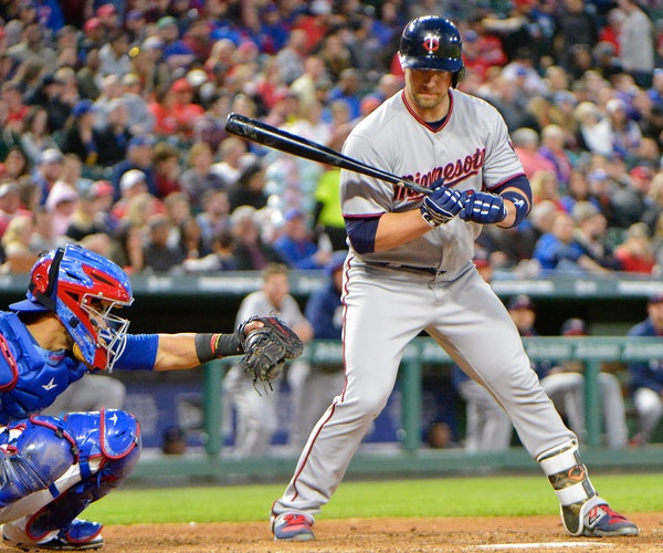The Twins' Chris Gimenez draws a walk during the fourth inning of a game in April against the Rangers at Globe Life Park in Arlington