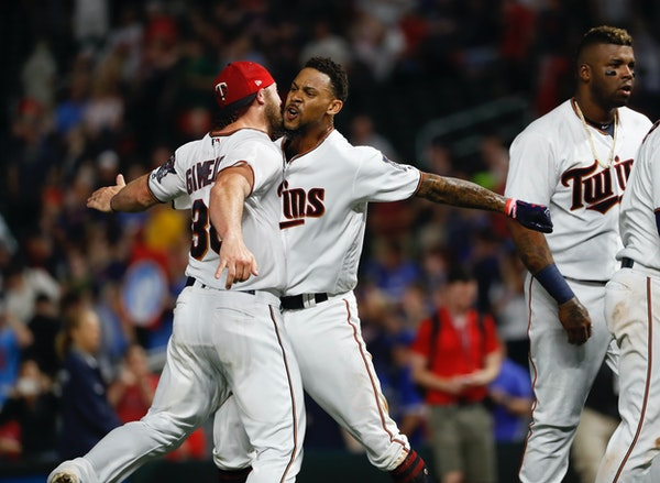 Twins center fielder Byron Buxton celebrated his 10th-inning walkoff home run to win Thursday's game 3-2 over Toronto with catcher Chris Gimenez