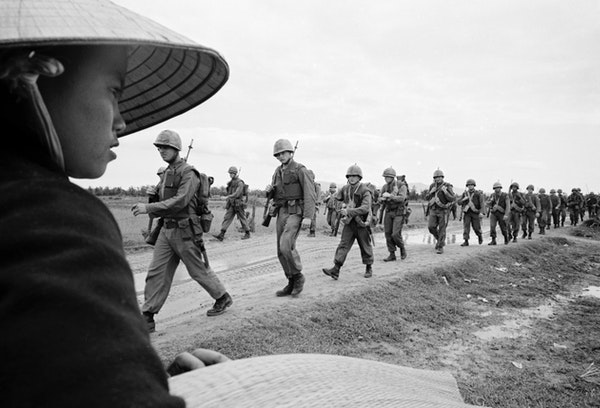 """Marines marching in Danang in a scene from """"The Vietnam War."""" Director Ken Burns said,""""Vietnam was a tale of morality with an identity that's"""