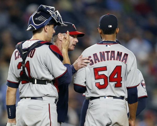 Twins catcher Jason Castro and manager Paul Molitor check on Twins starter Ervin Santana before removing Santana in the sixth inning against the New Y