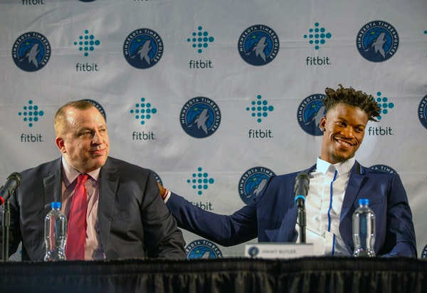 Timberwolves new point guard Jimmy Butler, right, pats coach Tom Thibodeau on the back during a news conference to welcome Butler to the team in June.