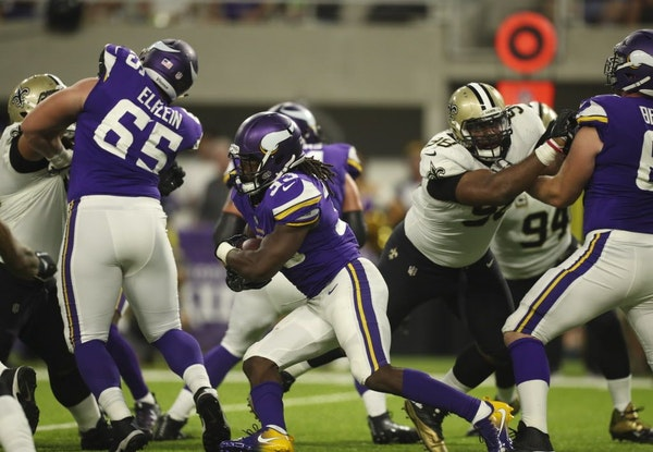 Vikings center Pat Elflein (65) helped clear the way for running back Dalvin Cook for a second-quarter run.