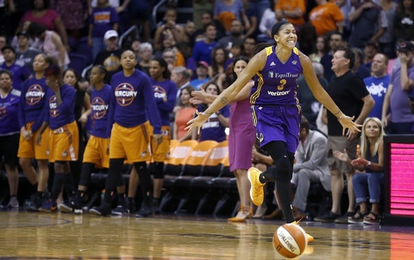 Los Angeles Sparks' Candace Parker, right, celebrates as time expires during the second half of Game 3 of a WNBA basketball playoff semifinal against