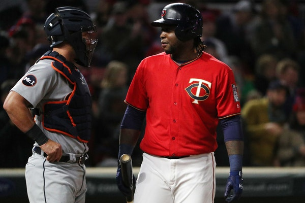 Twins slugger Miguel Sano talked with Detroit catcher James McCann as he went to bat in the seventh inning Friday night as a pinch hitter.