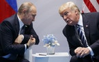 FILE - In this July 7, 2017 file photo, President Donald Trump meets with Russian President Vladimir Putin at the G20 Summit in Hamburg. Putin is more