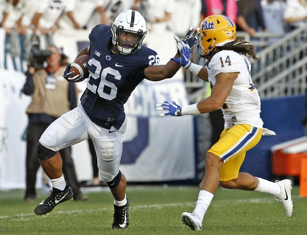 Will Saquon Barkley and Big Ten favorite Penn State survive a visit to Iowa City? Tune in Saturday night to find out. (AP photo by Chris Knight)