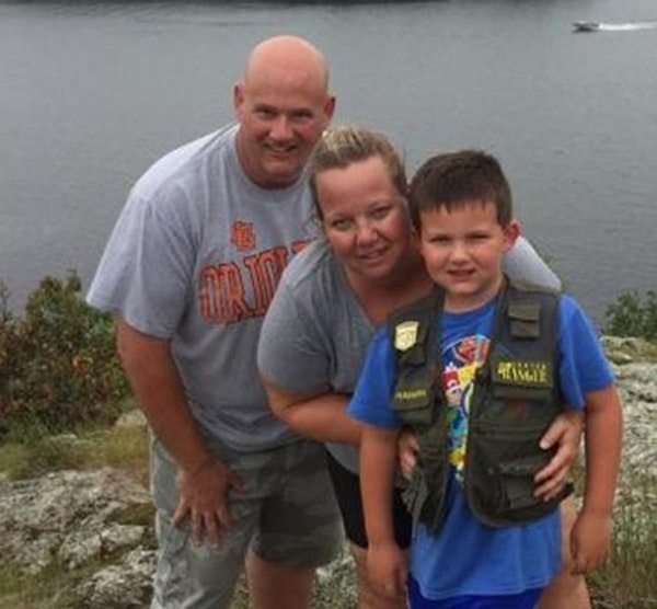 Wayzata officer William Allen Mathews with his wife and 7-year-old son.