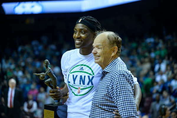 Minnesota Lynx center Sylvia Fowles with her league MVP trophy beside team owner Glen Taylor before Game 2 of the WNBA semifinals against the Washingt