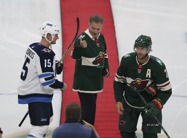 Finland President Sauli Niinisto gave a thumbs-up after he took part in a ceremonial dropping of the puck with Winnipeg Jets center Matt Hendricks (15