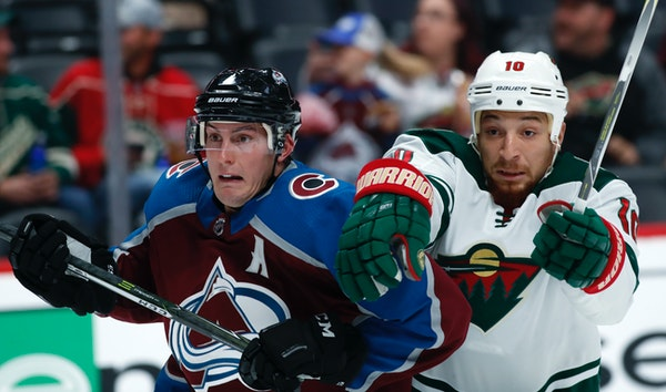 Avalanche defenseman Tyson Barrie, left, fought for position in front of the net with Wild right winger Chris Stewart in the second period Sunday.