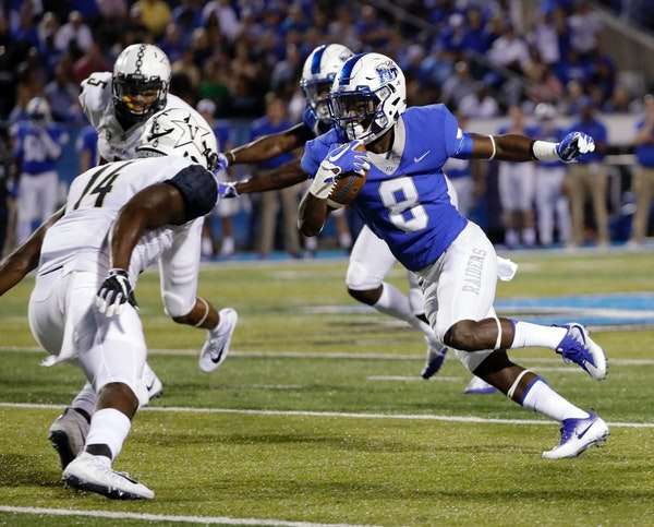 Middle Tennessee wide receiver Ty Lee (8) runs against Vanderbilt safety Ryan White (14) in the first half of an NCAA college football game Saturday,