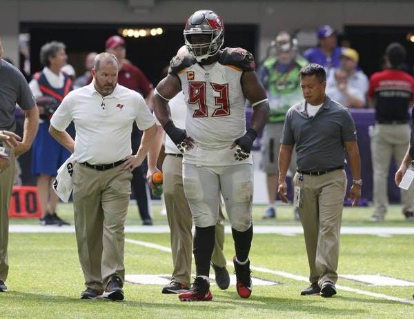 Tampa Bay Buccaneers defensive tackle Gerald McCoy (93) is helped off the field after getting injured during the second half of an NFL football game a
