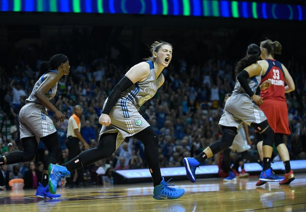 Minnesota Lynx guard Lindsay Whalen (13) celebrated after scoring a layup to put the Minnesota Lynx up by five points in the fourth quarter.