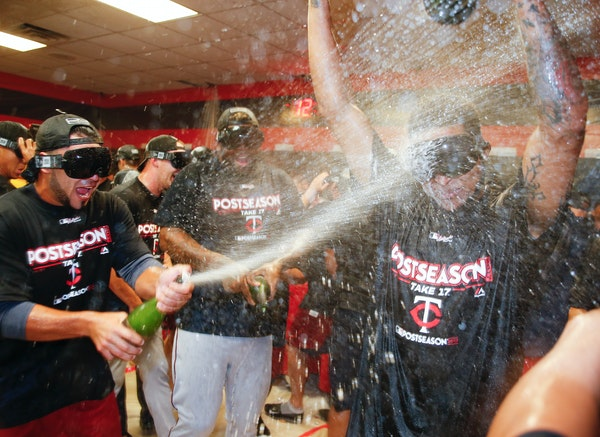 The Minnesota Twins celebrate early Thursday, Sept. 28, 2017, in Cleveland. The Twins earned an AL wild-card berth after the Los Angeles Angels lost t