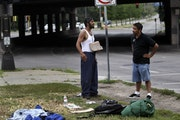 A street outreach worker from St. Stephen's Human Services with a homeless man near Hennepin and Lyndale avenues on the edge of downtown in 2012. The