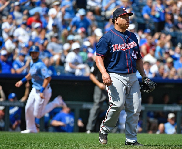 Minnesota Twins starting pitcher Bartolo Colon watches an RBI double by Kansas City Royals designated hitter Brandon Moss as Eric Hosmer scores in the