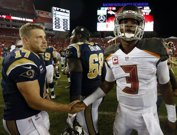 QB Case Keenum, left, has a good track record against the Buccaneers, beating them and counterpart Jameis Winston last year.