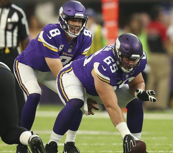 Minnesota Vikings center Pat Elflein (65) prepared to hike the ball to Minnesota Vikings quarterback Sam Bradford.