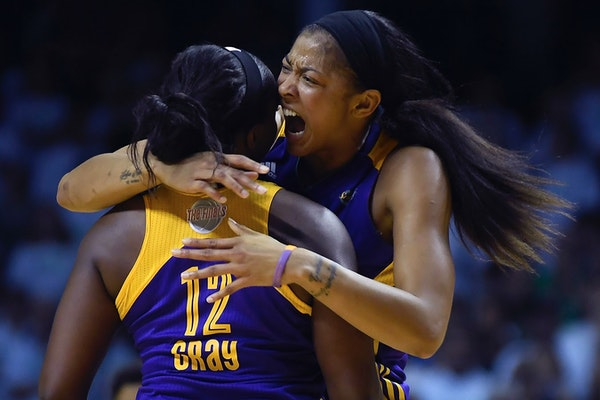 Los Angeles Sparks forward Candace Parker (3) celebrated with guard Chelsea Gray (12) after a traveling violation was called against Minnesota Lynx fo