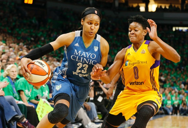 Maya Moore, left, drives around Los Angeles Sparks' Alana Beard in the second half during Game 5 of the 2016 WNBA Finals