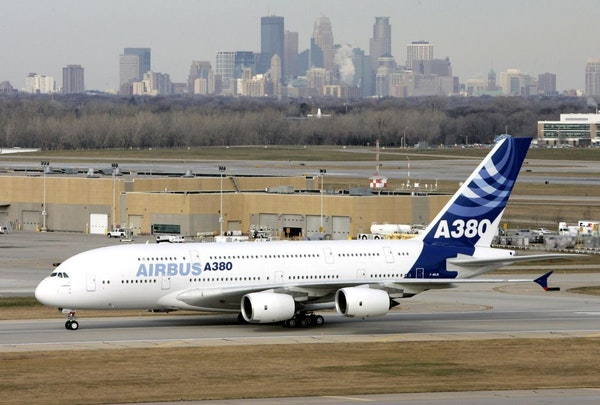 In this Nov. 27, 2007 file photo, the Minneapolis skyline rises in the distance as an Airbus A380 taxies at Minneapolis-St. Paul International Airport