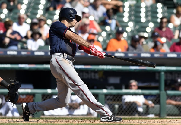 Minnesota Twins' Zack Granite (8) hits a sacrifice fly during the fourth inning of a baseball game against the Detroit Tigers, Sunday, Sept. 24, 201