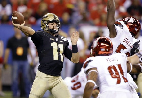 Purdue quarterback David Blough is dealing with a shoulder injury, but Gophers coach P.J. Fleck expects him to play Saturday. (AP photo by Michael Con