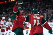 Minnesota Wild left wing Zach Parise (11) and right wing Nino Niederreiter (22) celebrated a goal by Niederreiter