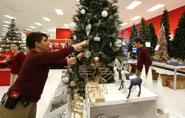 Nina Friis made a last minute touch up to a display at the Roseville Target store on Nov. 3, 2016.