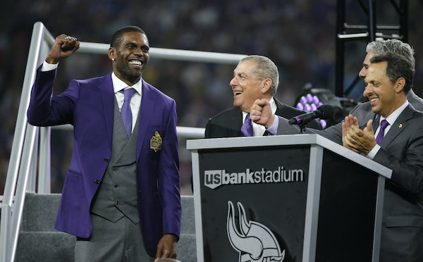 Former Minnesota Vikings wide receiver Randy Moss, left, reacts as he is inducted into the Vikings Ring of Honor. Will the Pro Football Hall of Fame b