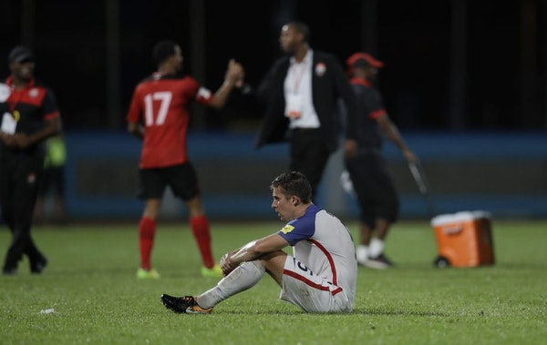 United States' Matt Besler, squats on the pitch after losing 2-1 against Trinidad and Tobago during a 2018 World Cup qualifying soccer match in Couva,