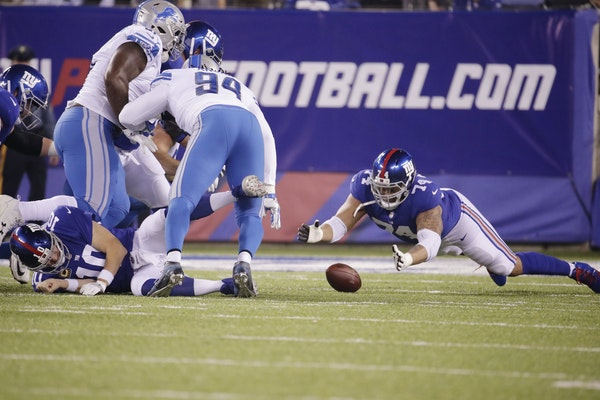 New York Giants offensive tackle Ereck Flowers (74) dives on the ball after quarterback Eli Manning (10) was hit during the first half.