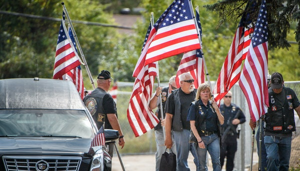Members of the Patriot Guard gathered at the entrance of Wayzata Free Church for the visitation of Wayzata police officer Bill Mathews, who was struck