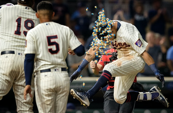 Eddie Rosario made his way to home plate after hitting a walk off 2-run home run in the tenth inning to win the game. Minnesota beat San Diego 3-1.
