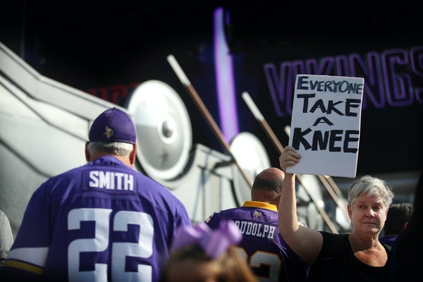 Linda Breitag held a sign up criticizing President Donald Trump's suggestion that they fire players who kneel for the national anthem at U.S. Bank Sta