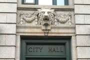A lion guards the doorway of Duluth City Hall