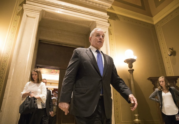 Gov. Mark Dayton walks out of the courtroom in the Capitol after oral arguments concluded.