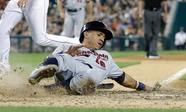 Minnesota Twins' Ehire Adrianza scores during the eighth inning of a baseball game against the Detroit Tigers, Saturday, Sept. 23, 2017, in Detroit. (