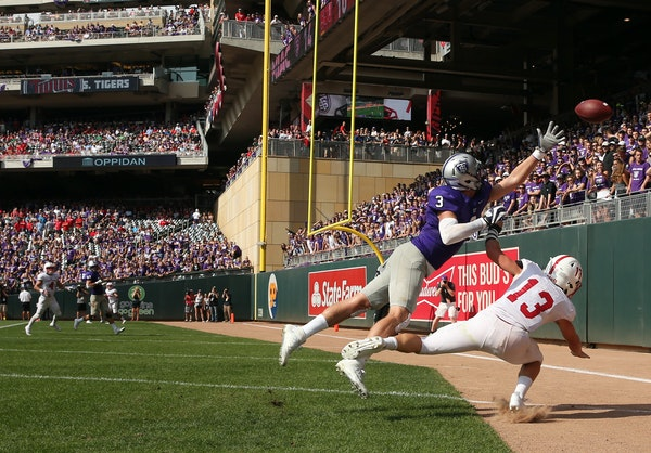 Fans in the Target Field outfield bleachers got a good look when St. Thomas receiver Tanner Vik couldn't quite grab a long pass as St. John's defe