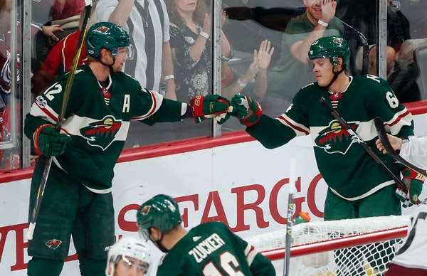 Minnesota Wild's Eric Staal, left, and Mikael Granlund celebrate Granlund's power-play goal off Colorado Avalanche goalie Jonathan Bernier on Saturday