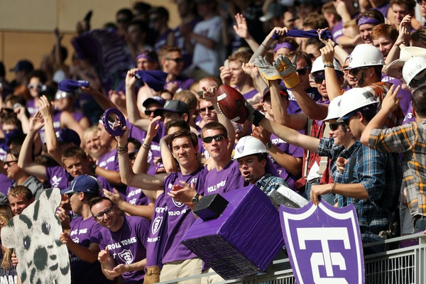 University of St. Thomas fans celebrated in the stands with the football after kicker Bryan Steinsapir made a field goal in the first half.