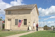 People tour the historic Kiesling House in New Ulm during an event marking the U.S.-Dakota War. Mandatory credit: Mankato Free Press file photo