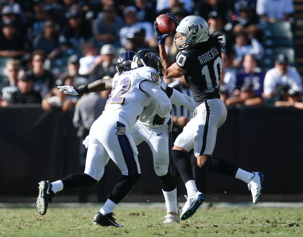 Oakland Raiders wide receiver Seth Roberts can't hold onto a catch against Baltimore Ravens safety Eric Weddle