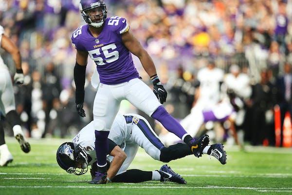Minnesota Vikings outside linebacker Anthony Barr (55) celebrated after sacking Baltimore Ravens quarterback Joe Flacco (5) in the third quarter at U.