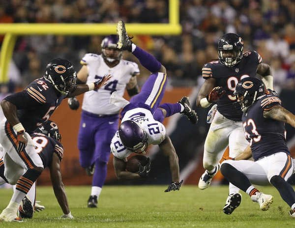 Vikings running back Jerick McKinnon was upended by Bears strong safety Adrian Amos (38) after a short pass reception in the first half. McKinnon late