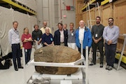 In September, researchers and visitors to the Smithsonian Institution warehouse in Suitland, Md., posed with the ancient sandstone jar given as a gift